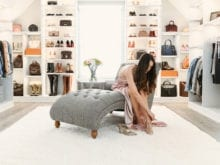 Vlogger Shea Whitney sitting in her custom walk-in closet | California Closet