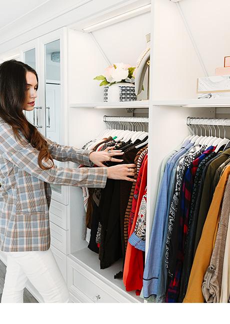 Vlogger Shea Whitney in custom white walk-in closet | California Closets