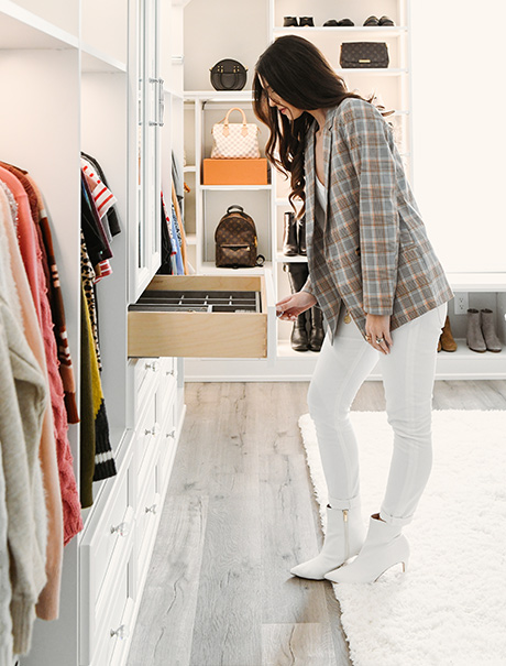 Vlogger Shea Whitney admiring the custom drawers in her walk- in closet | California Closets