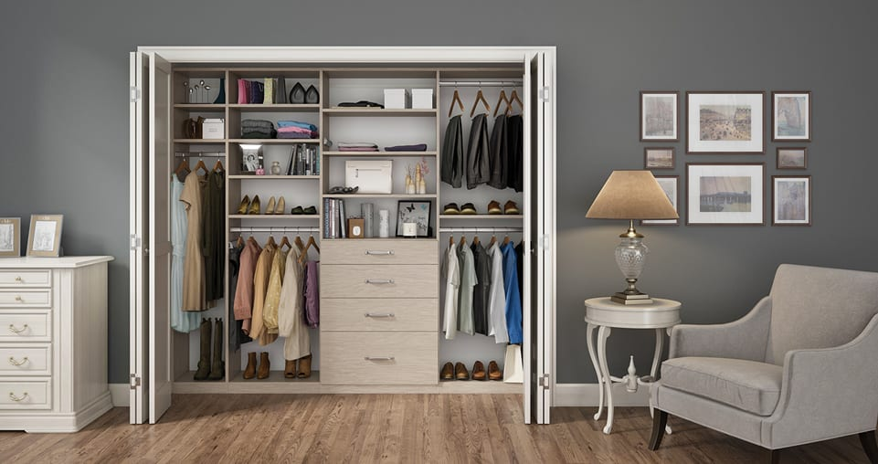 Light grey reach-in closet with drawers