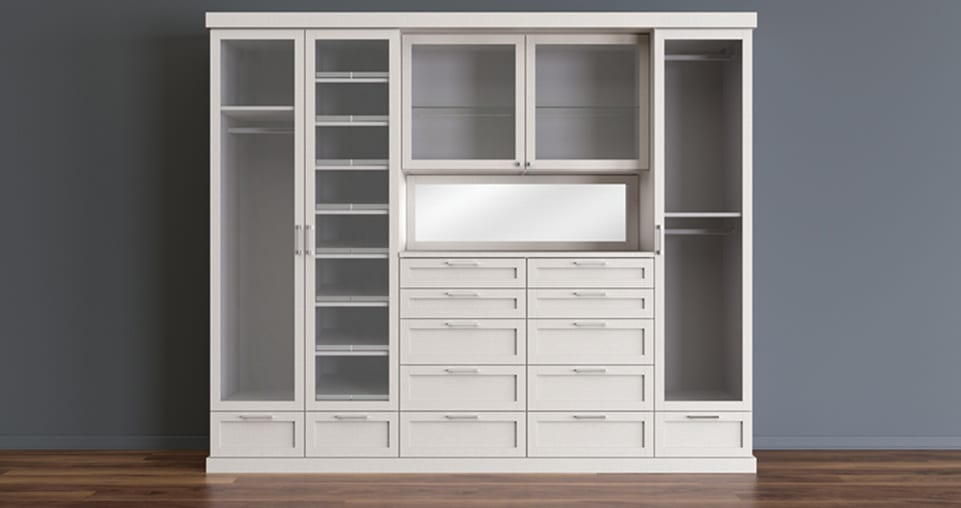 Reach-in closet with drawers and doors