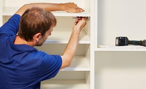 California Closets installer hanging closet shelves